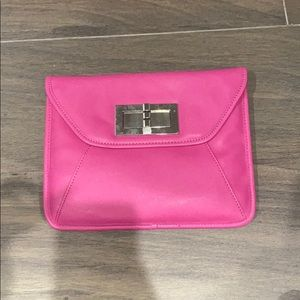 Pink leather clutch with metal chain strap